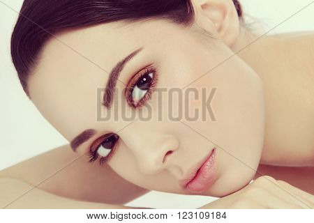 Vintage style close-up portrait of young beautiful woman with stylish make-up