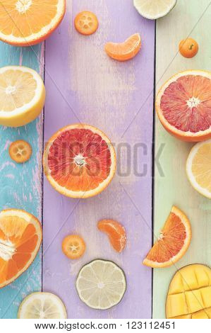 Citrus Salad with Mango, ingredients. Colorful sliced fruits background, ingredients for mango citrus salad . Top view, vintage toned image, blank space