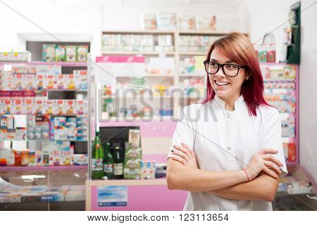 Smiling Woman Pharmacist In Front Of The Desk