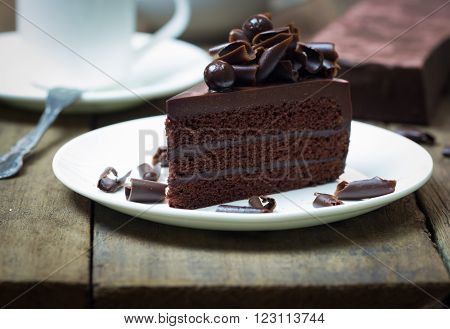 Chocolate Cake Topping With Chocolate Curl On Wood Background