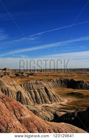 Badlands National Park under cirrus cloudscape in the Black Hills of South Dakota