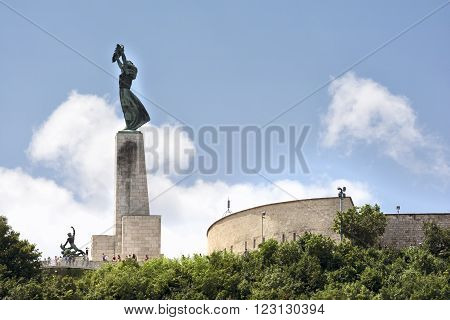 BUDAPEST, HUNGARY, JULY 10, 2015: Liberty Statue, a monument on the Gellert Hill , commemorates those who sacrificed their lives for the independence, freedom, and prosperity of Hungary.