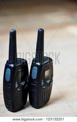 Two black compact professional portable radio sets with maps
