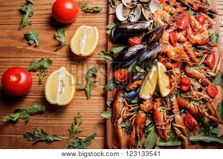 Fresh Mussels, Crayfish, Shrimp On A Wooden Board. Seafood Platter