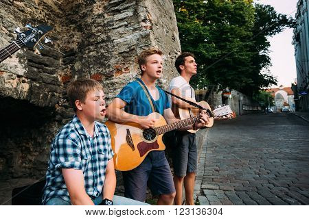 Tallinn, Estonia - July 25, 2014: Street Musicians Buskers Play Evening Near Famous Viru Gate In Old Part Of City Tallinn. Viru Gates were built in the 14thC, still standing today.