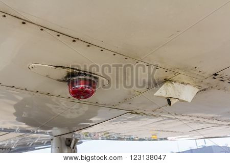 Amsterdam Schiphol Airport North Holland/the Netherlands - March 10 2016: light on underside of a KLM Fokker 100 passenger aircraft on the viewing platform