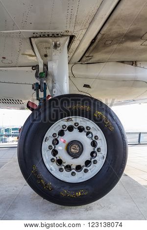 Amsterdam Schiphol Airport North Holland/the Netherlands - March 10 2016: landing wheels of a KLM fokker 100 passenger aircraft