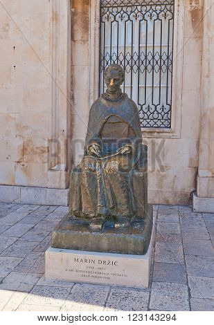 DUBROVNIK CROATIA - JANUARY 20 2016: Monument to Marin Drzic in Dubrovnik (UNESCO site) Croatia. Marin Drzic (1508-1567) is considered the finest Croatian Renaissance playwright and prose writer