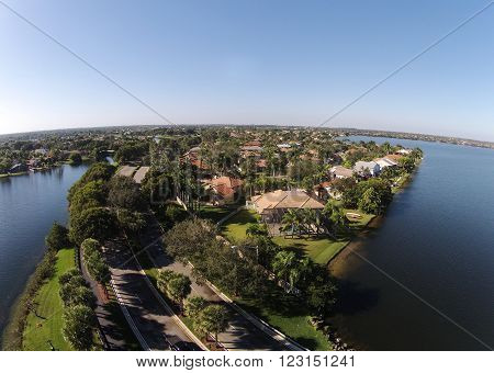 Suburban waterfront homes in Florida seen from above