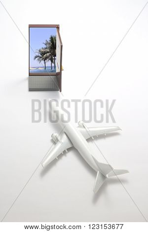 Trip by airplane to the resort. Miniature airlane flies toward the beach.