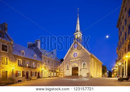 Quebec City - June 20: Notre-Dame-des-Victoires at Place Royale in Quebec City Canada with its old buildings on June 20 2013