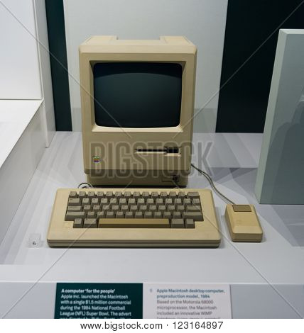 SCIENCE MUSEUM, LONDON - FEBRUARY 08, 2016: Old original Apple Mac computer with keyboard on display in a glass case in a museum, in London, UK, detailing the advancement of technology