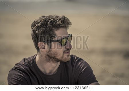 portrait of a man on the beach