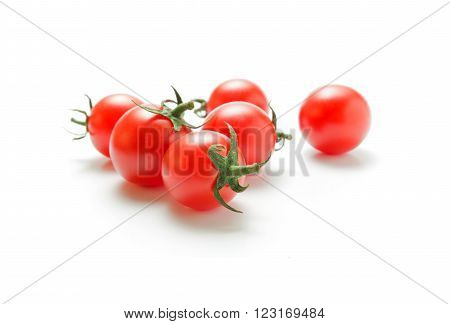 Fresh ripe cherry tomatoes closeup isolated on white background.