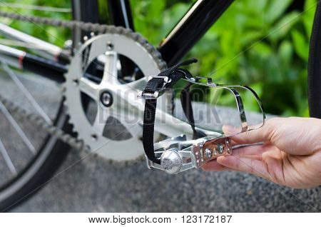 Close up of hand with bicycle pedal