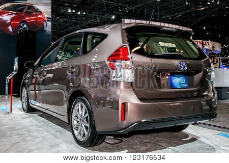 NEW YORK - March 23: A Toyota Prius V on exhibit at the 2016 New York International Auto Show during Press day,  public show is running from March 25th through April 3, 2016 in New York, NY.