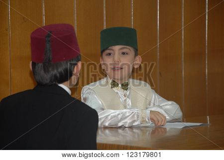ANKARA/TURKEY-MARCH 12, 2015: Primary school students at the Author of the Turkish National Anthem Mr. Mehmet Akif Ersoy's memorial day. March 12, 2015-Ankara/Turkey