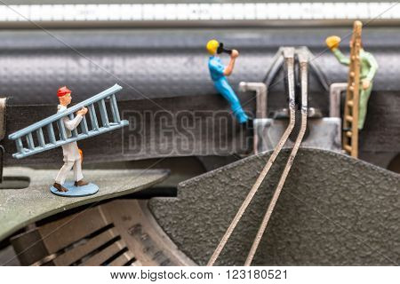 Team of workers performing maintenance activity with working tools