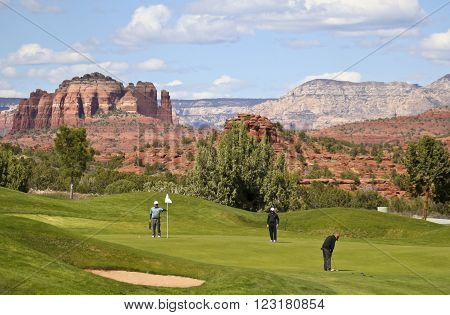 OAK CREEK VILLAGE, ARIZONA, MARCH 8. The Sedona Golf Resort on March 8, 2016, in Oak Creek Village, Arizona. A golfer putts on the 3 par Hole 10 of the Sedona Golf Resort course famous for its spectacular views.