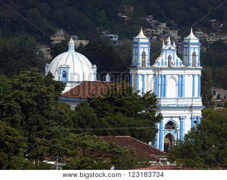 The blue colonial Santa Lucia church as seen from a hill in San Cristobal de las Casas Chiapas Mexico.