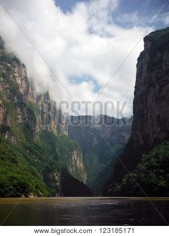 A vista of the famous Sumidero Canyon as seen from a river boat in Chiapas Mexico.