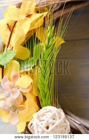 Detail Of Wicker Wreath With Artificial Flowers