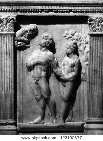 God punishes Adam and Eve expelling them from Paradise. The sculpture in the Cathedral of Siena. 12-13 century. Sienna. Italy
