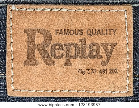 CHISINAU MOLDOVA - March 08 2015: Close up of the Replays leather label on the blue jeans. Replay - Italian brand one of the leaders in the world of men's and women's denim clothing.
