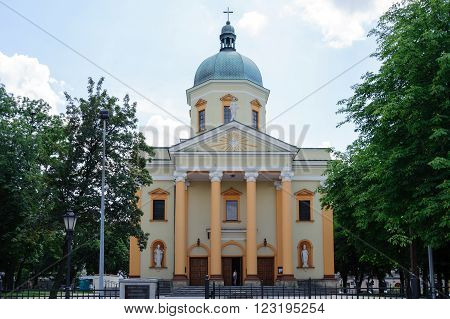 RADOM, POLAND - JULY 4, 2009: St. Stanislaw garrison Church with two large statues of the Polish patrons St. Wojciech and St. Stanislaw