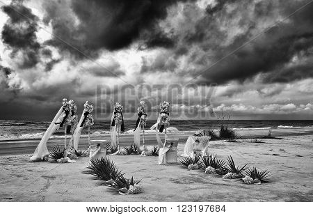 A Dramatic Image of a Wedding Set Up on a Stormy Beach. Filter applied for effect.