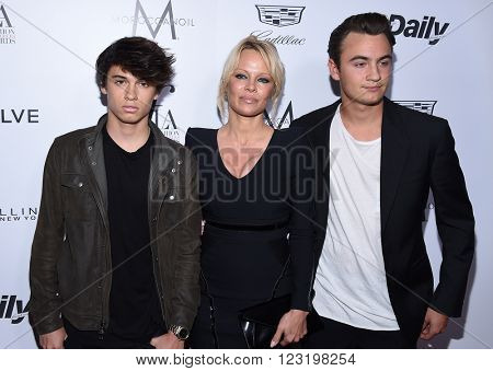 LOS ANGELES - MAR 20:  Pamela Anderson, Dylan Lee & Brandon Lee arrives to the 2nd Annual Fashion Los Angeles Awards  on March 20, 2016 in Hollywood, CA.