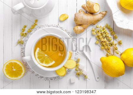 tea cup with lemon, ginger and herbs