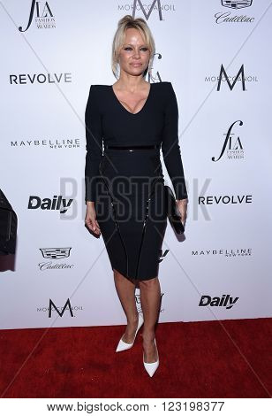LOS ANGELES - MAR 20:  Pamela Anderson arrives to the 2nd Annual Fashion Los Angeles Awards  on March 20, 2016 in Hollywood, CA.