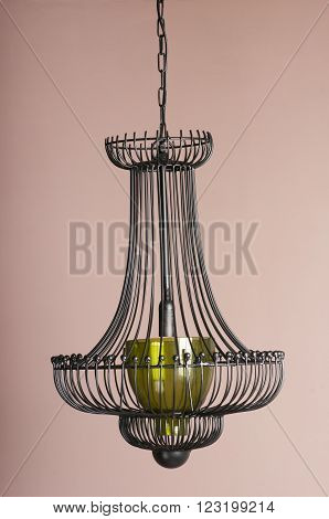black chandelier close-up isolated on a purple background
