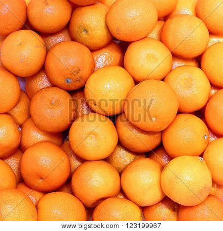 Background from a lot of bright orange tangerines