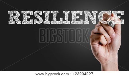 Hand writing the text: Resilience