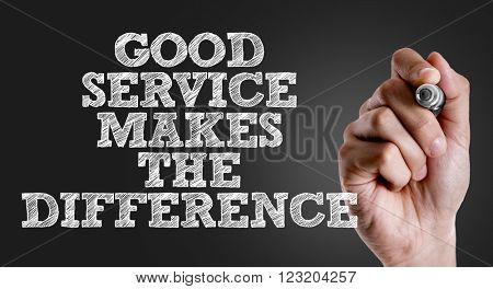 Hand writing the text: Good Service Makes the Difference