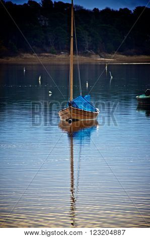 Cotuit skiff or mosquito sits in harbor