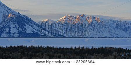Mount Saint John at sunset in the Grand Tetons Mountain Range in Grand Tetons National Park in Wyoming USA
