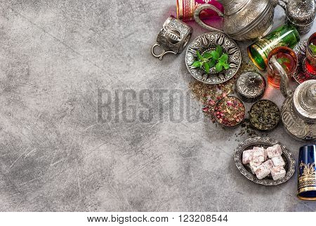 Tea table place setting with colorful glasses. Oriental hospitality concept