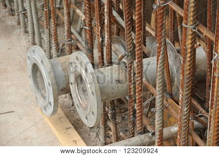 MALACCA, MALAYSIA -OCTOBER 13, 2015: Pipe flanges for water tank install before the concreting work at the construction site.