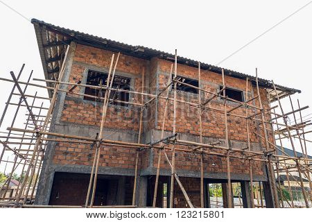 Building Residential Construction House With Scaffold For Construction Worker