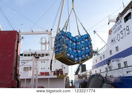 Sea of Okhotsk, Russia - October 2th, 2014: Sea of Okhotsk, the work of team seamens in hold of sea refrigerator ship CRISTAL AFRICA.