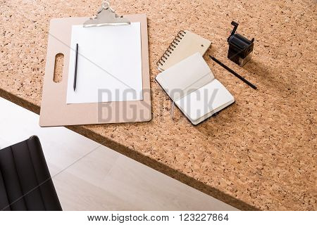 Cork table with notepad datebook pencil and sharpener. Concept of work. Mock up. 3D render