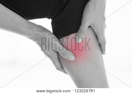 Front view of a young women calf muscle pain. Red around the pain area.