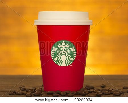 Bangkok, Thailand - November 10, 2015: The new paper cup of Starbucks stores in the country for the Christmas on a red background cup of Starbucks logo. Starbucks brand is one of the world famous coffeehouse chains from USA.