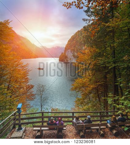 Relax at Konigssee lake in autumn. View of Koenigssee ( King's Lake) surrounded by alpine mountains from Malerwinkel viewpoint in Autumn ~ Beautiful scenery of Bavarian countryside in Berchtesgaden Germany.