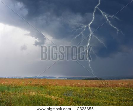 Thunderstorm With Lightning In Meadow. Dark Ominous Clouds.