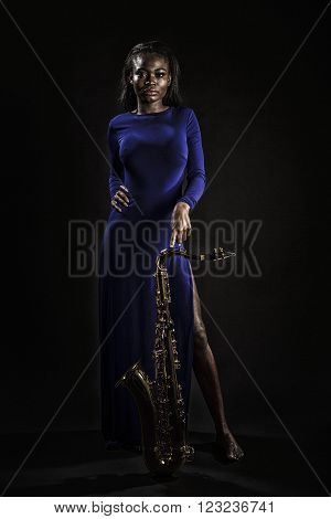 Attractive African lady posing with her tenor saxophone