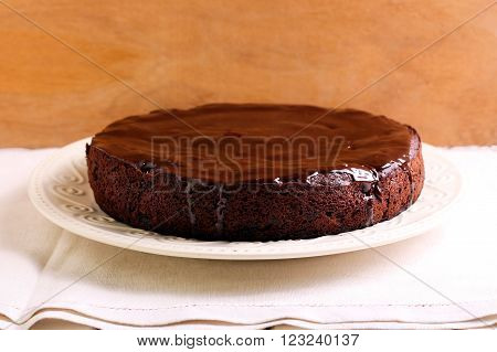 Chocolate sponge cake with chocolate icing on plate